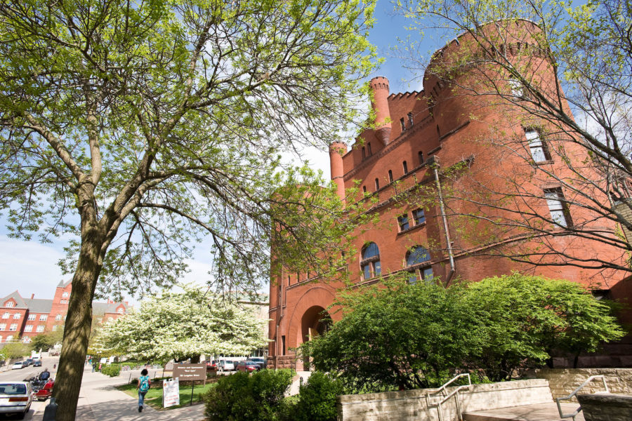 Budding trees frame the Armory and Gymnasium (Red Gym) at the University of Wisconsin-Madison during spring