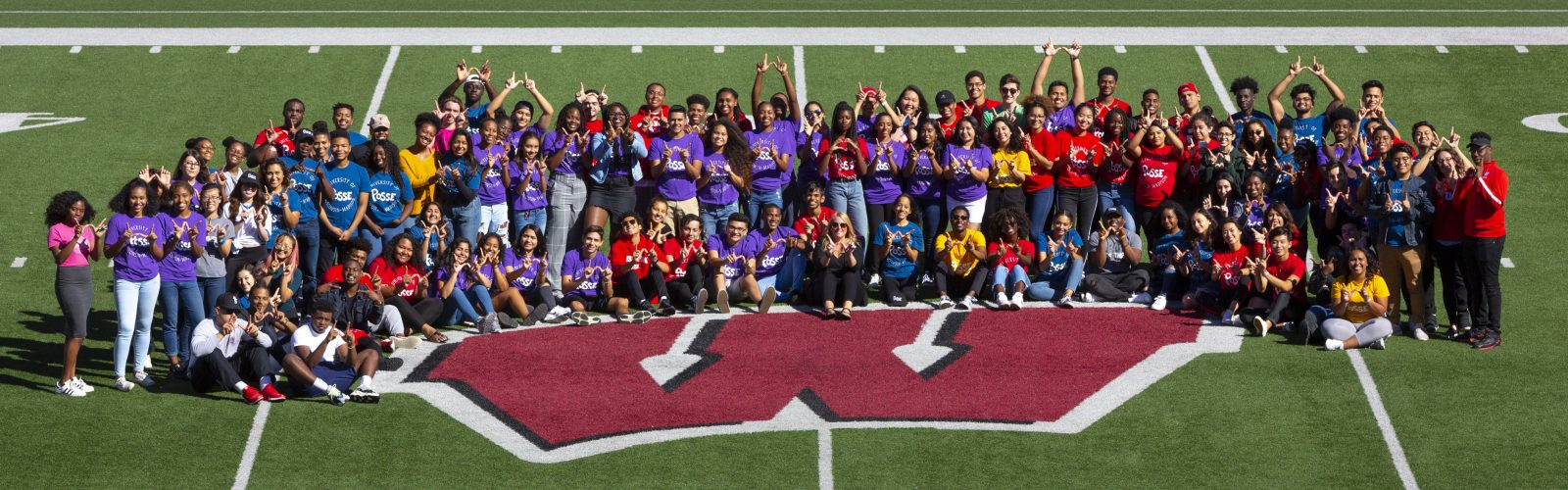 Group photo of Posse Scholars at Camp Randall on the 50 yard line.